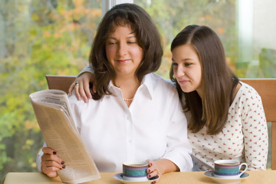 Mother reading Financial Education Book to her daughter