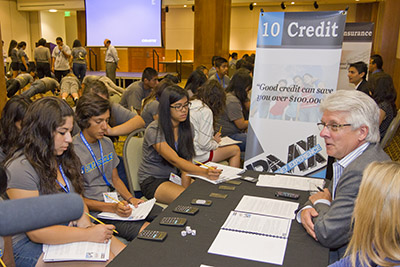 Student benefit from a financial knowledge test at a Real Money Experience event.
