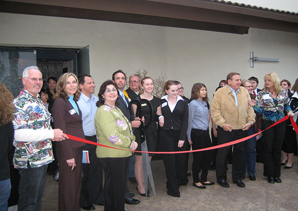 Vince Shorb cuts ribbon to promote financial literacy
